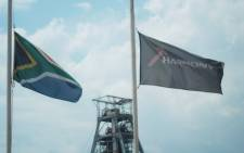 Flags fly at half mast at the Harmony Gold Doornkop mine on the West Rand following the deaths of eight miners, 6 February 2014. Picture: Govan Whittles/EWN.