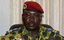 Burkina Faso's Lieutenant-Colonel Isaac Zida attends a press briefing at the end of a meeting with the country's military commanders at the military headquarters in Ouagadougou on 1 November, 2014.