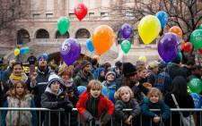 Children and adults watch as balloons are inflated and prepared prior to Thursday's Macy's Thanksgiving Day Parade on 23 November 2016 in New York City. Picture: Getty Images/AFP.