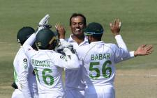 Pakistan's Nauman Ali (2R) celebrates with teammates after taking the wicket of South Africa's Anrich Nortje (not pictured) during the fourth day of the first cricket Test match between Pakistan and South Africa at the National Stadium in Karachi on 29 January 2021. Picture: Asif Hassan/AFP