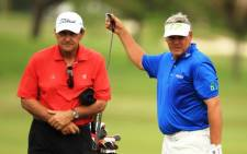 Darren Clarke pulls a club alongside Bob Rotella during the final practice round prior to the start of the World Golf Championships-Cadillac Championship on the TPC Blue Monster at Doral Golf Resort And Spa on 7 March 2012 in Miami, Florida. Picture: AFP.