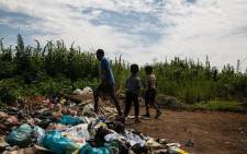 Children play at a dump site in Ebumnandini in Ebumnandini on the West Rand where residents leave their waste. Picture: Kayleen Morgan/EWN