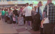 Passengers stand in line at Egypts Sharm el-Sheikh airport. Picture: Supplied.