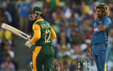 Sri Lanka's Lasith Malinga look on as South Africa's Quinton de Kock takes a run during the 2015 Cricket World Cup quarter-final match between Sri Lanka and South Africa in Sydney on 18 March, 2015. Picture: AFP.