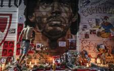 View of an improvised altar set up by Fans of Argentinos Juniors' football team, where Argentinian football legend Diego Maradona used to play, outside Argentinos Juniors' Diego Armando Maradona Stadium in La Paternal neighbourhood, Buenos Aires, on 25 November 2020, on the day of his death. Picture: AFP