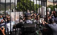 FILE: Police attempt to keep UCT #FeesMustFall students out of parliament. Picture: EWN