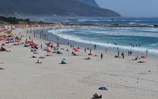 Beachgoers cool down at Camps Bay on a hot summer's day. Picture: EWN