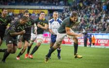 Springbok lock Eben Etzebeth powers towards the try line during the team's game against the World XV at Newlands on 11 July 2015. Picture: Aletta Gardner/EWN