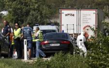 FILE: An abandoned refrigerated lorry filled with corpses of migrants was found by an Austrian motorway patrol near the Hungarian border on 27 August 2015. Picture: AFP.