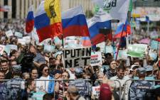FILE: Demonstrators take part in a rally to support opposition and independent candidates after authorities refused to register them for September elections to the Moscow City Duma, Moscow, 20 July 2019. Picture: AFP.