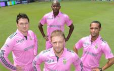 Graeme Smith (L), AB de Villiers (front), Lonwabo Tsotsobe (back) and Robin Peterson (R) pose in the pink kits in aid of the Pink Drive Campaign. Picture: CSA.