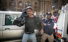 eNCA cameraman Pierre le Roux pulls away from a JMPD officer during a scuffle on 26 May 2015. Picture: Cornel van Heerden.