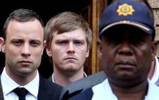 Murder accused Oscar Pistorius is escorted out of the High Court in Pretoria on day 10 of his murder trial. Picture: Sebabatso Mosamo/EWN.