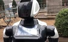 A YouTube screengrab shows an autonomous service robot.
