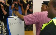 Archbishop Emeritus, Desmond Tutu casts his ballot at Milnerton Library as the media captures the moment. Picture: Danya Philander/Eyewitness News