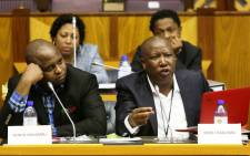EFF leader Julius Malema makes his representation to Parliament's powers and privileges committee in Cape Town, Tuesday, 7 October 2014. Also pictured is Floyd Shivambu (L). Picture: Sapa.