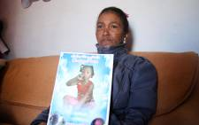 Juanita Pieters holds a picture of her youngest daughter, Courtney Pieters. A year on and the Pieters family still want answers about their daughter's death. Picture: Bertram Malgas/EWN
