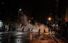 People fleeing as police use water cannons and rubber bullets to disperse them from the streets of Hillbrow, in what was believed to be a #FreeZuma protest on 11 July 2021. Picture: Boikhutso  Ntsoko/ Eyewitness News.