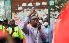 Transport Minister Fikile Mbalula addresses members of the Gauteng traffic police, taxi associations and commuters outside the MTN Noord taxi rank on 1 April 2020. Picture: Kayleen Morgan/EWN