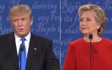 Republican presidential nominee Donald Trump speaks as Democratic presidential nominee Hillary Clinton listen during the presidential debate at Hofstra University on 26 September 2016 in Hempstead, New York.  Picture: CNN