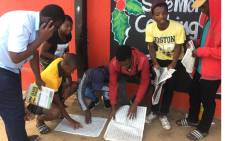 Matriculants check their results. Picture: Supplied