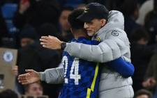 Chelsea defender Reece James (L) embraces Chelsea head coach Thomas Tuchel (R) at the end of the English League Cup round of 16 football match between Chelsea and Southampton at Stamford Bridge in London on 26 October 2021. Picture: Glyn Kirk/AFP