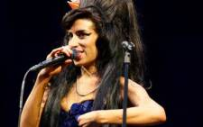 British singer Amy Winehouse performs at the 2008 Glastonbury Festival. Picture: AFP