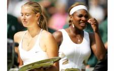 Maria Sharapova of Russia and Serena Williams of the US carry their trophies after their ladies final match at the 118th Wimbledon Tennis Championships in Wimbledon in July 2004. Picture: AFP