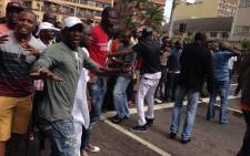 FILE: Police try to disperse a large crowd of around 2,000 people following a standoff between foreign shop owners and locals in Durban on 14 April 2015. Picture: EWN.