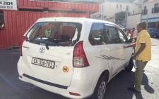 A damaged vehicle is seen during a protest by metered taxi drivers against Uber in the Cape Town CBD. Picture: Supplied.