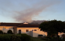 FILE: Fire above Noordhoek towards Silvermine as seen from Fishoek, choppers busy. Picture: Paul van As @Lightningman Twitter.