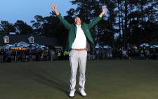 FILE: Australian golfer Adam Scott celebrates winning the 2013 Masters at Augusta, Georgia, on 14 April 2013. Picture: AFP