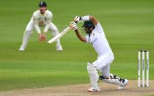 Pakistan's Babar Azam plays a shot during the first day of the first Test cricket match between England and Pakistan at Old Trafford in Manchester, northwest England on 5 August 2020. Picture: AFP