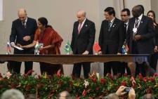 FILE: Delegates of the countries members of the BRICS (Brazil, Russia, India, China and South Africa) sign the creation of their new development bank during the 6th BRICS Summit in Fortaleza, Brazil, on 15 July 2014. Picture: AFP.