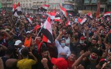 Iraqi protesters gather during an anti-government demonstration in the Iraqi capital Baghdad on 25 October 2019. Picture: AFP