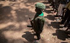 FILE: Newly released child soldiers stand with rifles during their release ceremony in Yambio, South Sudan, on 7 February, 2018. Picture: AFP