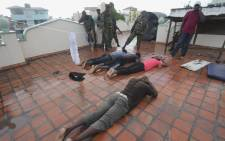 Kenyan police officers arrest Muslim youths at Masjid Shuhada mosque in the coastal city of Mombasa, Kenya, 17 November 2014. Picture: EPA.
