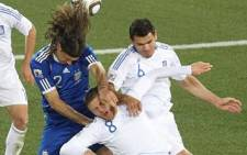 Heads, I win: Argentine defender Martin Demichelis (blue shirt) wins a header against two Greek players during a 2010 World Cup match in Polokwane. Picture: AFP