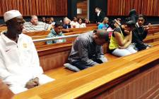 The four people accused of killing Kirsty Theologo in a satanic ritual in 2011 in court during the passing of judgment. From left, Harvey Isha, Robin Harwood, Courtney Daniels and Lindon Wagner. Picture: Vumani Mkhize/EWN.