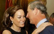 This file photo taken in October 2003 shows Prince Charles being greeted by British socialite Tara Palmer-Tomkinson during a reception at Clarence House. Picture: AFP.