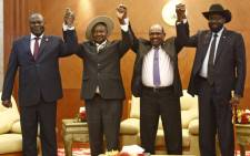 From left to right, South Sudan's opposition leader Riek Machar, Ugandan President Yoweri Museveni, Sudanese President Omar al-Bashir and South Sudanese President Salva Kiir, pose for a group picture before their meeting in khartoum on 25 June 2018. Picture: AFP