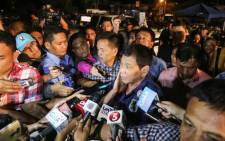 Philippine President Rodrigo Duterte speaks to members of the media as he visits the site of an explosion at a nigth market in Davao City in southern island of Mindanao early 3 September, 2016. Picture: AFP.