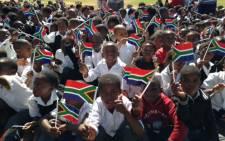 School children waving SA flag during the Steyn City Christmas drive in Diepsloot. Picture: Vumani Mkhize/EWN