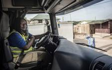 Abigail Asumadu-Amoah, one of Ladybird Logistics' 21 female employees, drives a tanker truck to the Ghanstock depot in Takoradi, western Ghana, on 3 April 2019. Picture: AFP