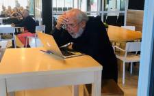 Michel Mayor checks his messages after winning the 2019 Nobel Prize for Physics on 8 October 2019. Picture: @NobelPrize/Twitter
