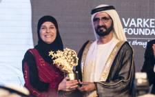 A Palestinian school teacher, Hanan Al Hroub, has won a $1 million education award for helping children to learn through play. Picture: Varkey Foundation.