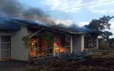 YouTube screengrab of a house on fire in Coligny.