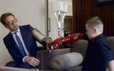 A disabled young boy who loves superheroes was given a shock when Iron Man actor Robert Downey Jr. gave him a bionic arm. Picture: Supplied/EWN.