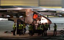 Swiss pilot Bertrand Piccard (L) speaks with his colleague, Swiss pilot Andre Borschberg on board the Solar Impulse 2 before taking off in Abu Dhabi, UAE on 9 March 2015. Picture: AFP.