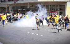 FILE: Police use a stun grenade to disperse marching Ses'Khona members who were fighting with Somali nationals near Bellville Station. It is unclear who started the fight. Picture: Thomas Holder/EWN